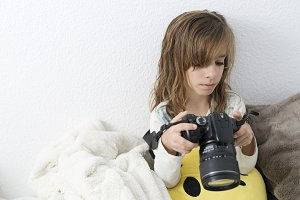 Girl with a camera in her hands