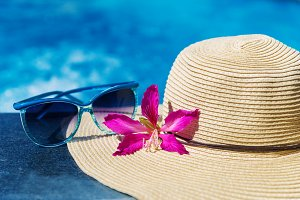Sunglasses with flower and straw hat