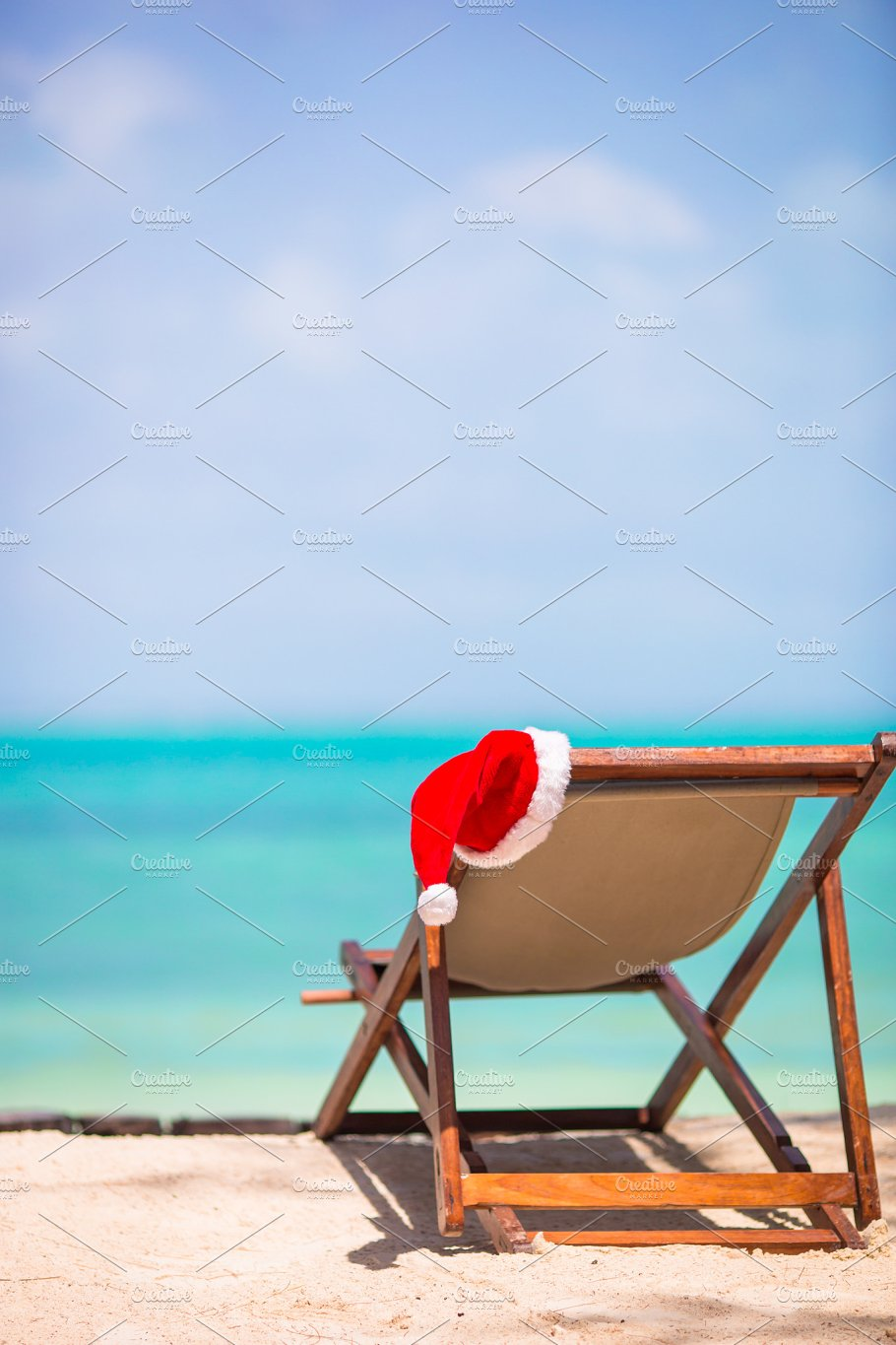 christmas on the beach chair with santa hats at sea christmas vacation concept