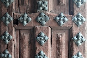 antique wooden door with nails