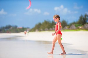 Cute little girl at beach during tropical vacation