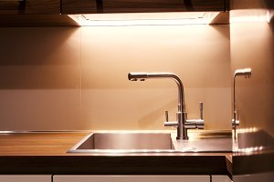 Close-up of modern kitchen faucet and sink
