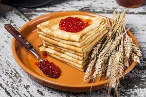 Pancakes with salmon caviar