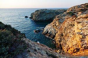 Rocky coast near Agia Pelagia at sunset - Crete Island, Greece