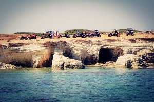 Sea Caves, Paphos District, Cyprus - July 24, 2015: Tourists on quadrocycles