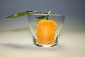 square tangerine in a glass