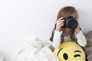 Little girl making a photo.