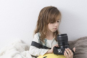 Girl with a camera in her hands.