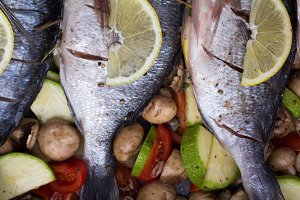 dorado with vegetables closeup