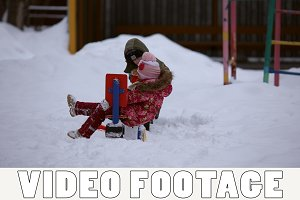 Girl and boy are playing in winter