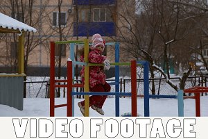 Girl playing on sports playground