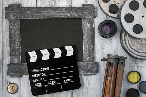 Clapperboard, reels of film