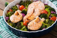 Baked salmon steak with vegetables.