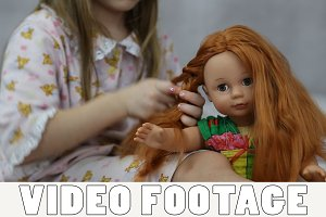 Girl playing with doll