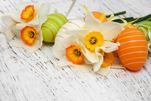 Easter eggs and daffodils flowers