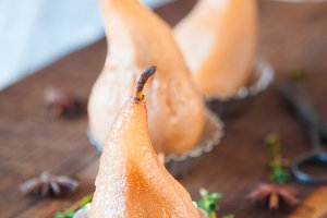 Golden poached  in wine pears