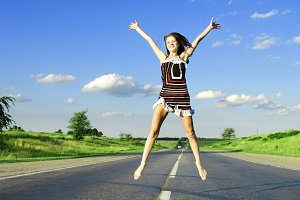 Jumping happy woman