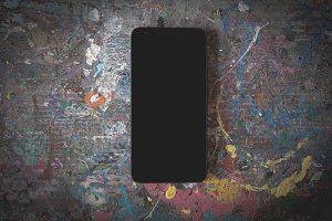 Smartphone on art table blank