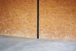 brick wall texture background and small gravel stone