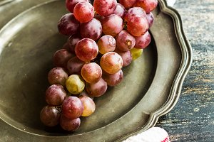 Organic grapes on porcelain plates