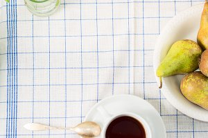 Table cloth with a cup of tea and fruit