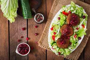 Meat cutlets with cranberry sauce