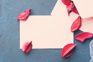 Blank paper note for Valentine's day with flower petals