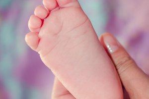 Tiny baby's foot