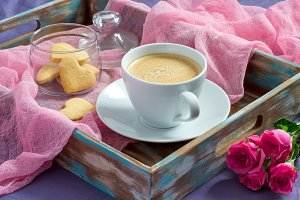 Breakfast Valentine's Day. tray with coffee, cookies and roses