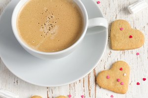 Cup of coffee and cookies for Valentine's Day