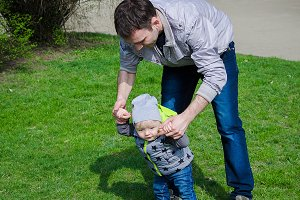Father helping his son for the first steps