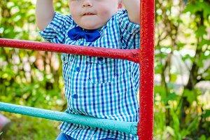 Little toddler boy having fun at a playground