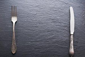 Silver cutlery on a dark