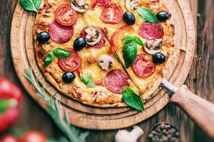 Pizza with mushrooms, salami