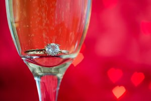 Proposal with ring in champagne glass