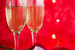 Valentines day background with champagne, ring and rose