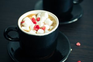 Coffee with marshmallow and small hearts.