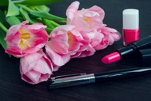 Bouquet of pink tulips with women's accessories