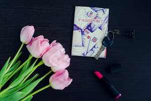 Bouquet of pink tulips with passport