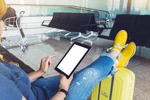 The traveler enjoys the tablet