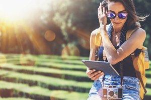 Woman using tablet plniruet journey