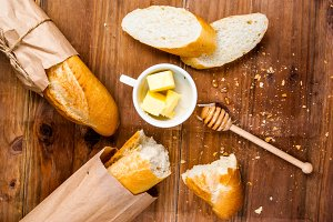 White baguette with butter and honey