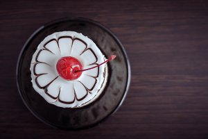 Sweet cake with a cherry