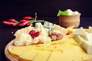 Tasty appetizer. Plate of Cheese.