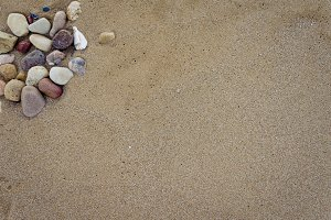Beautiful sand background with stones