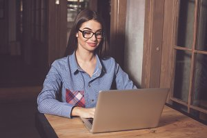 woman is working with grey laptop