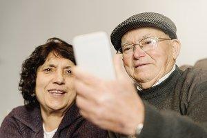 Senior marriage using his mobile.