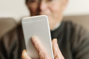 Senior man using his mobile.