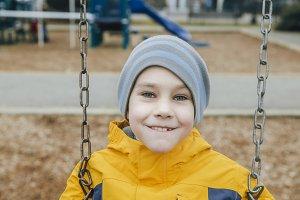 happy boy on a swing