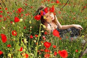 woman in bright red poppy  wreath
